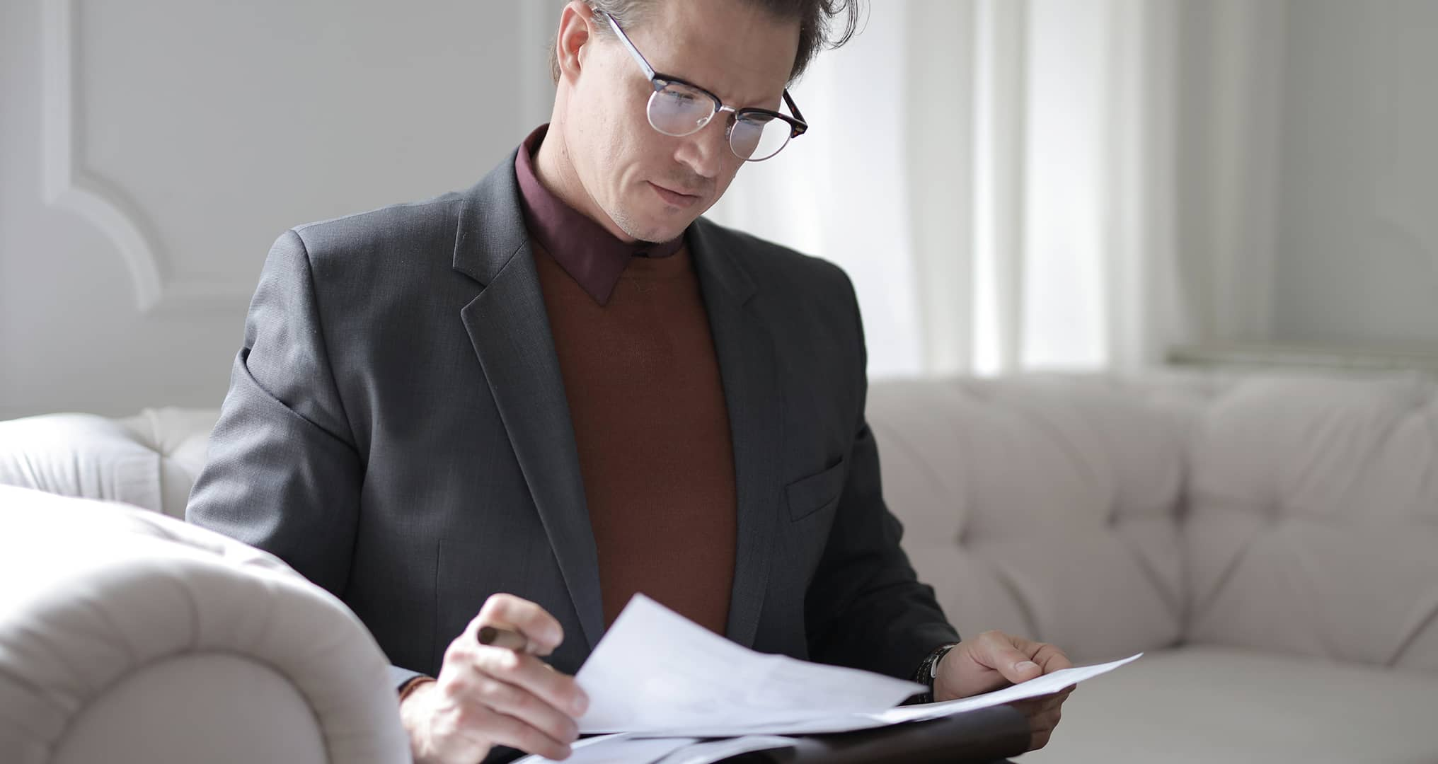 business man reading through client contract