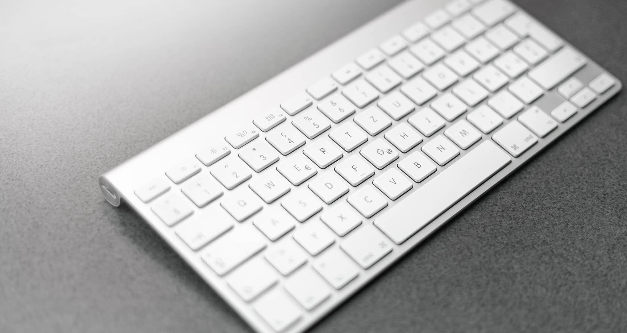 apple keyboard on desk