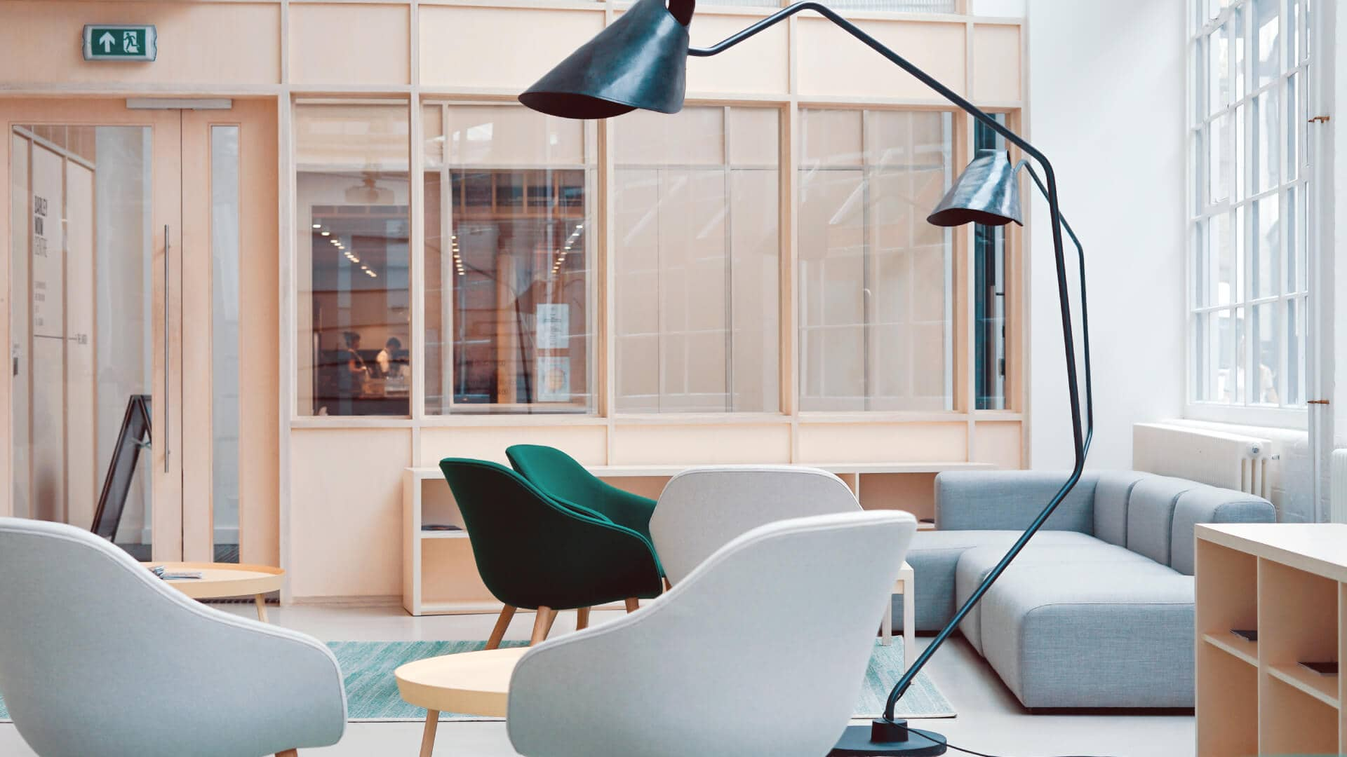 office interior design example with grey chairs and black lamps