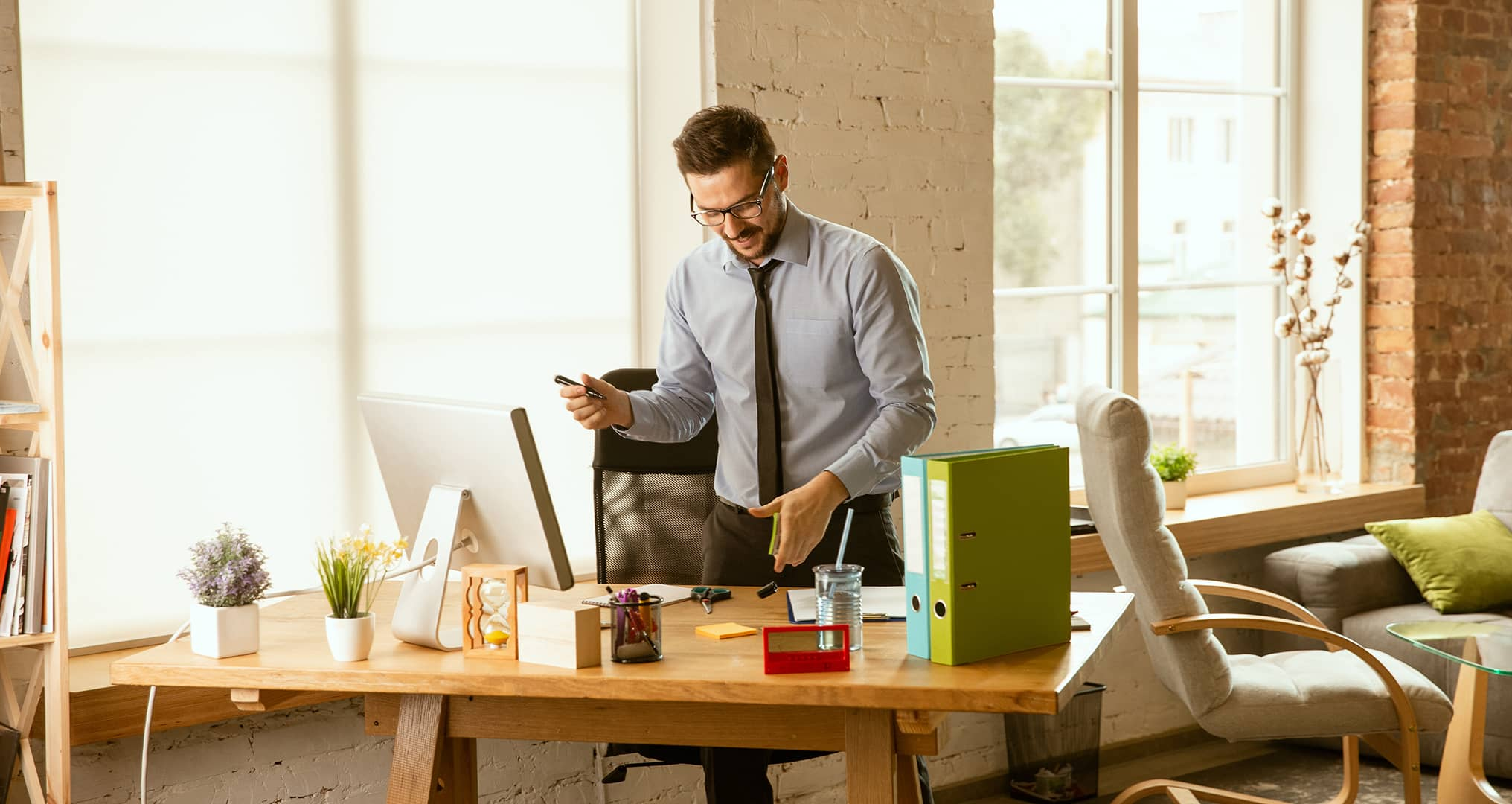 man working at sit to stand desk
