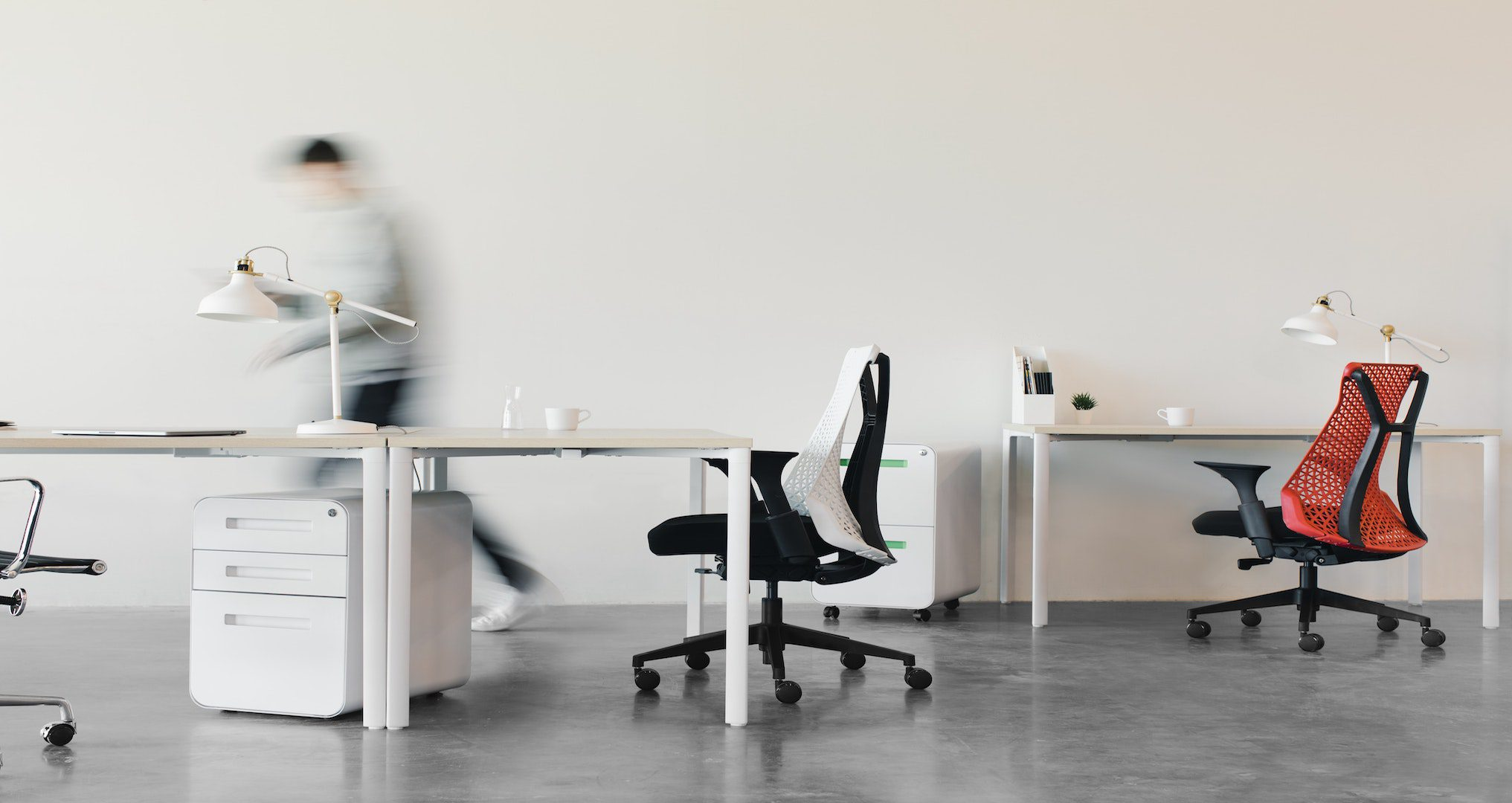 empty office desks and chairs