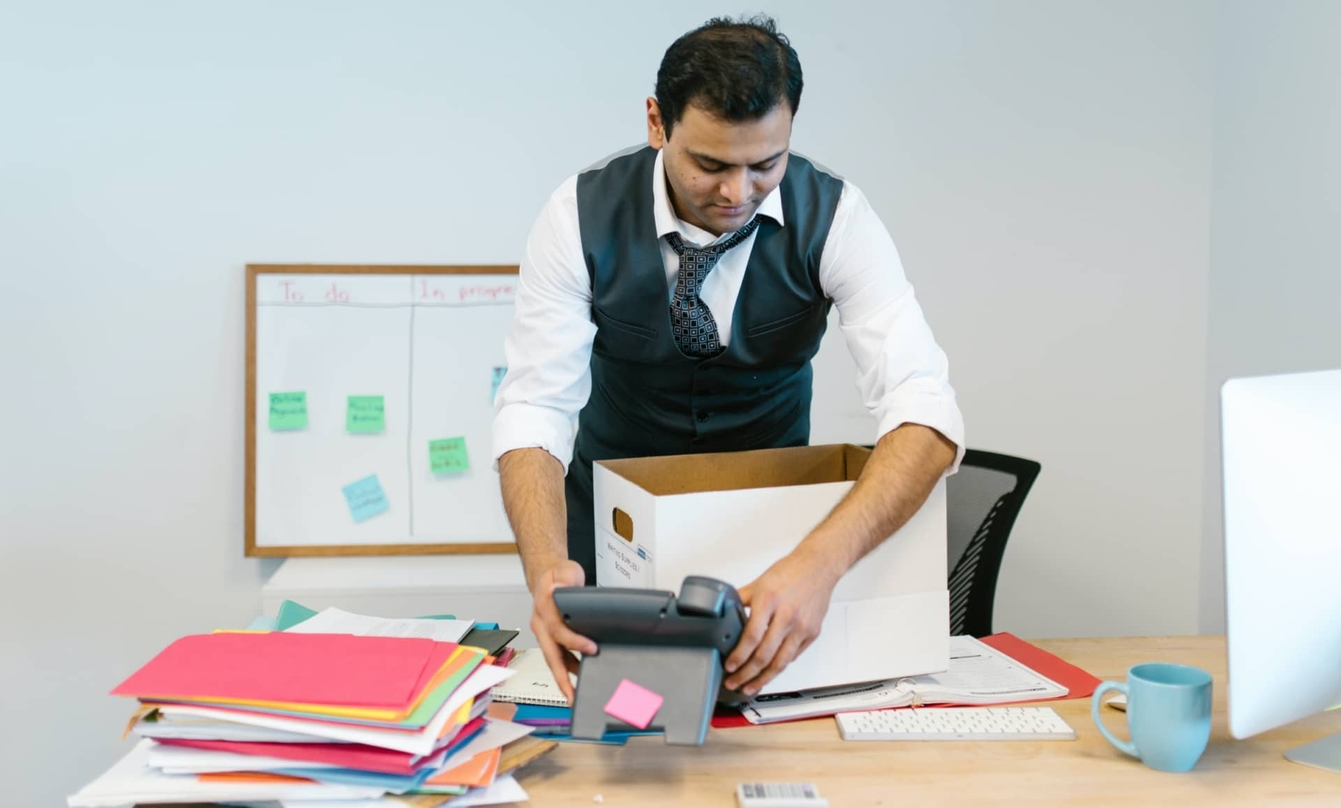 man cleaning up his desk