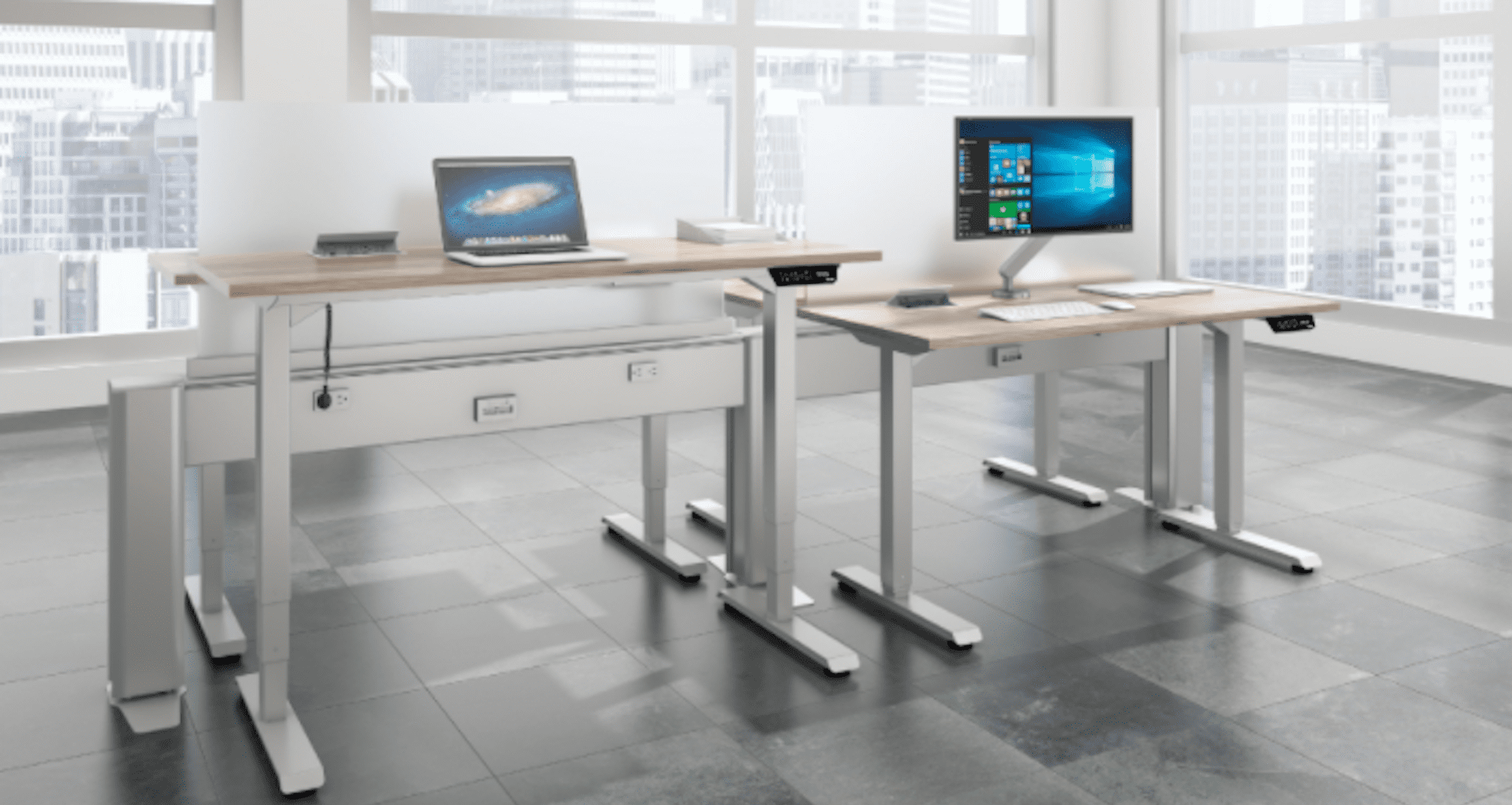 desks in room with large windows