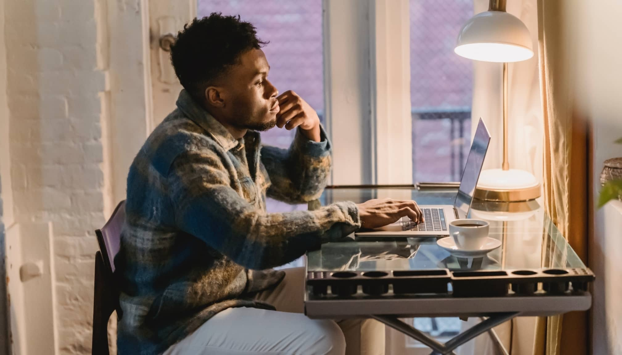 Man working from home contemplating new project