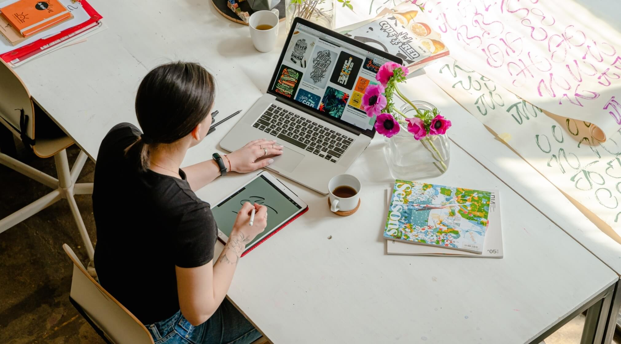 woman working on laptop and ipad
