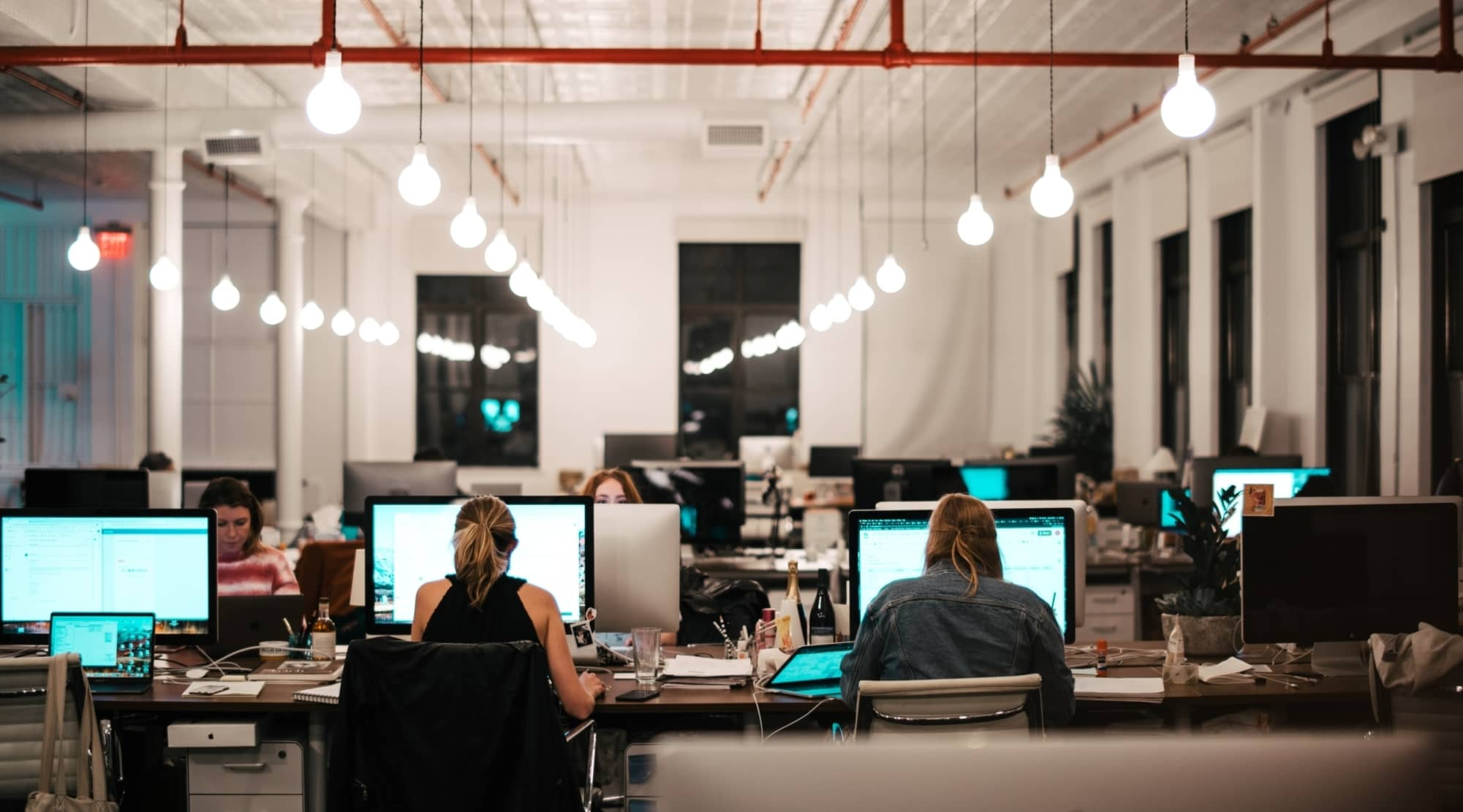 open office concept with employees working on projects at desks