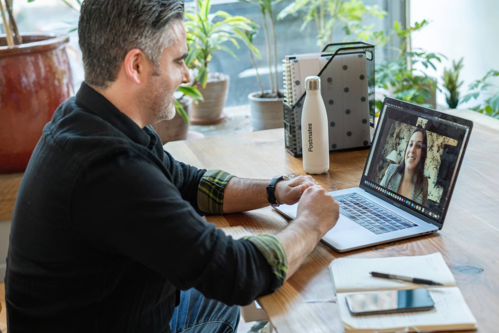 man on zoom call on laptop