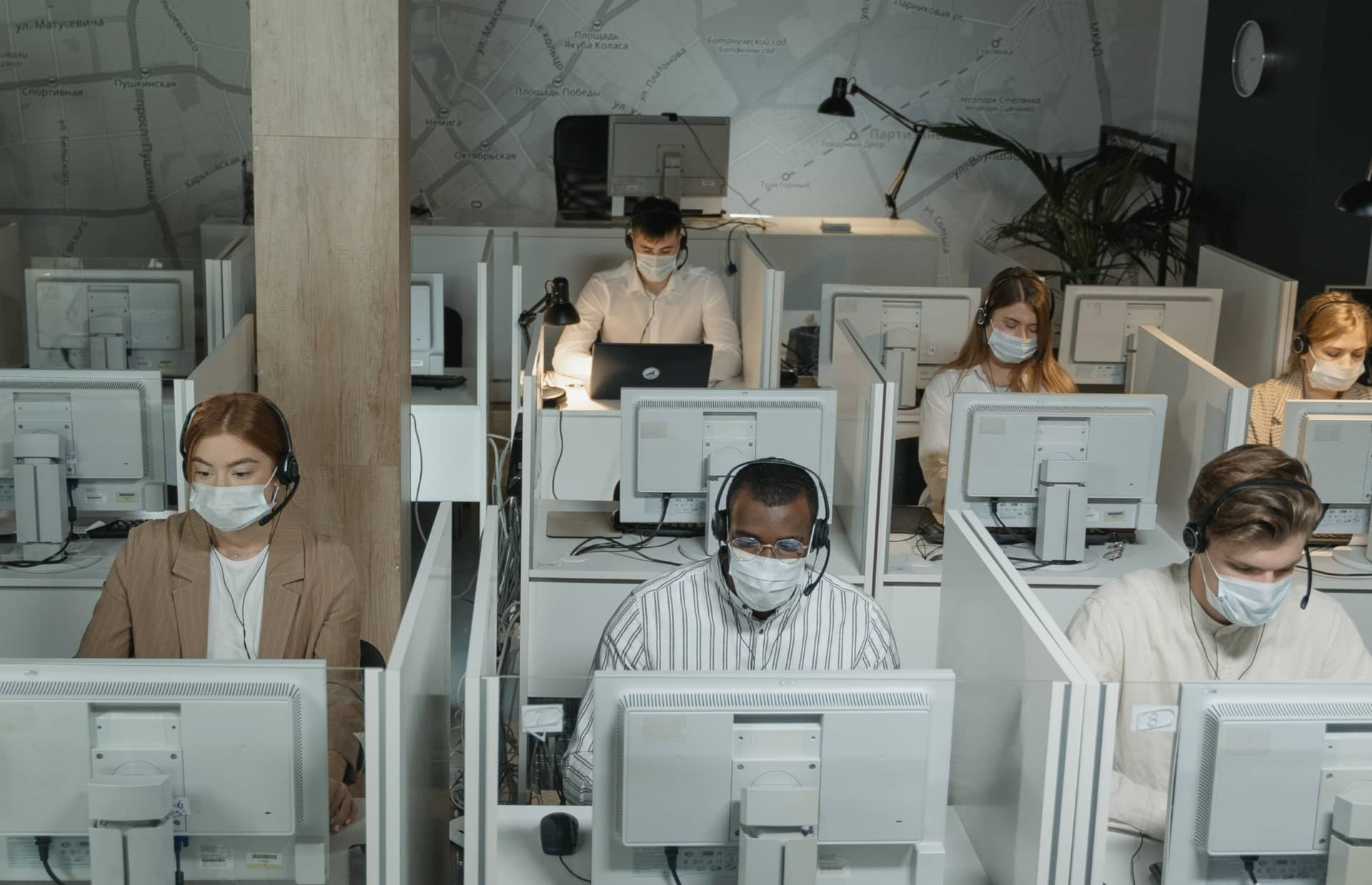 cubicles with people wearing masks