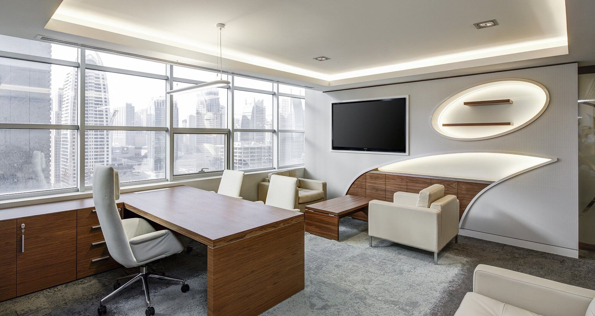 modern office with sitting area and view of the city