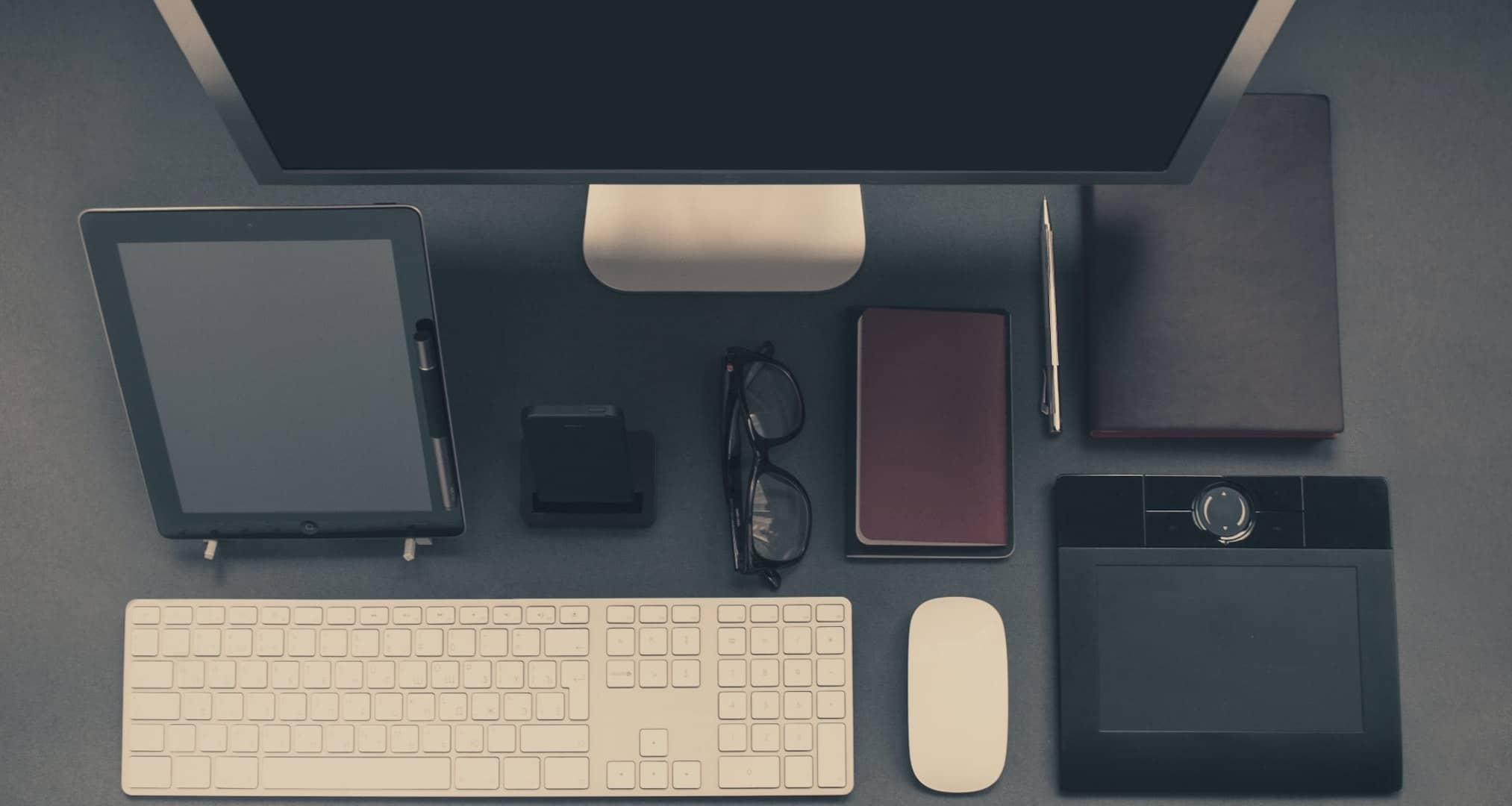 organized desk with all items needed for a productive day