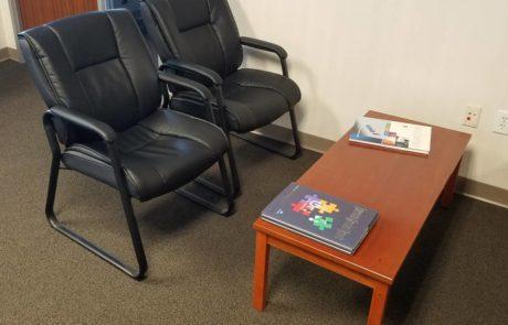 2 black waiting room chairs