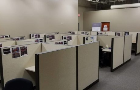 multiple office cubicles with office chairs