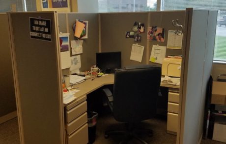 Office cubicle setting with high back office chair