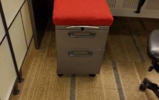 file cabinet with red cushion