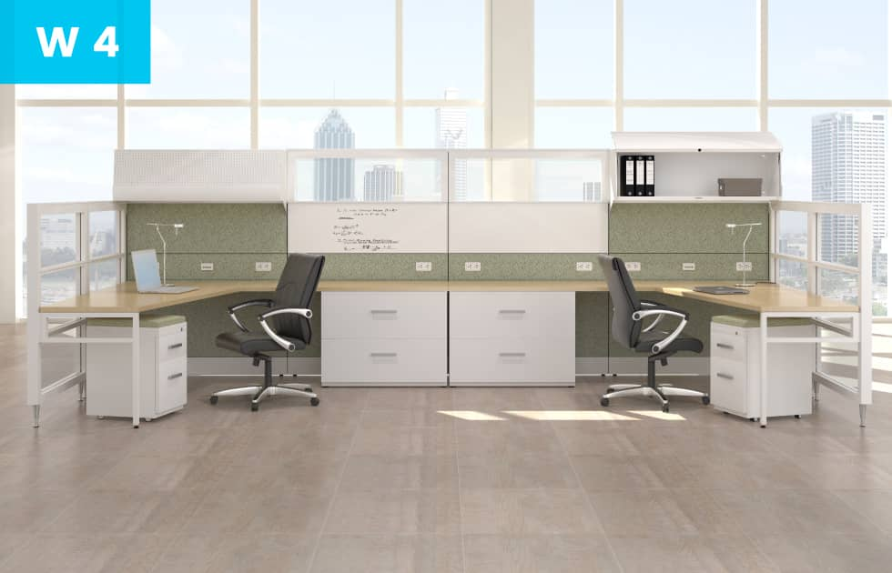 office workstation with green corkboard backing