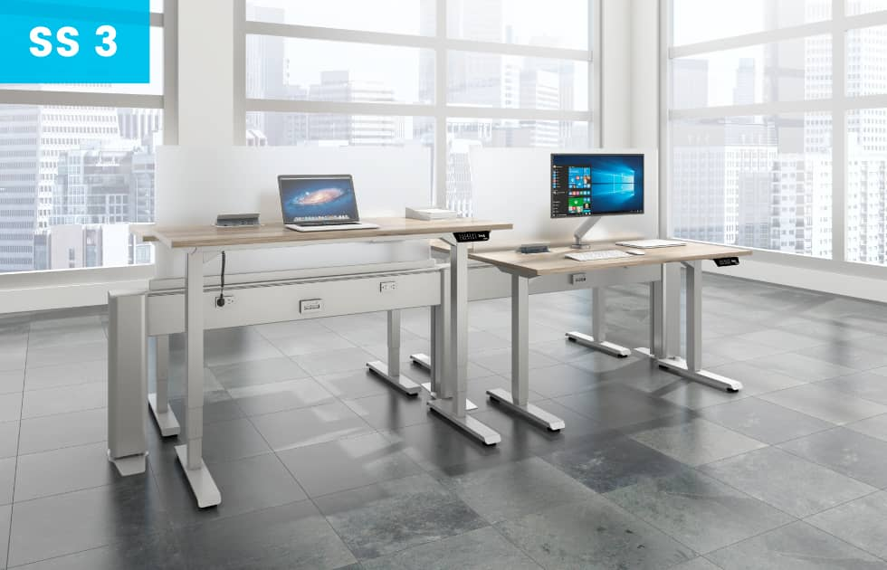 sit to stand office desks with computers