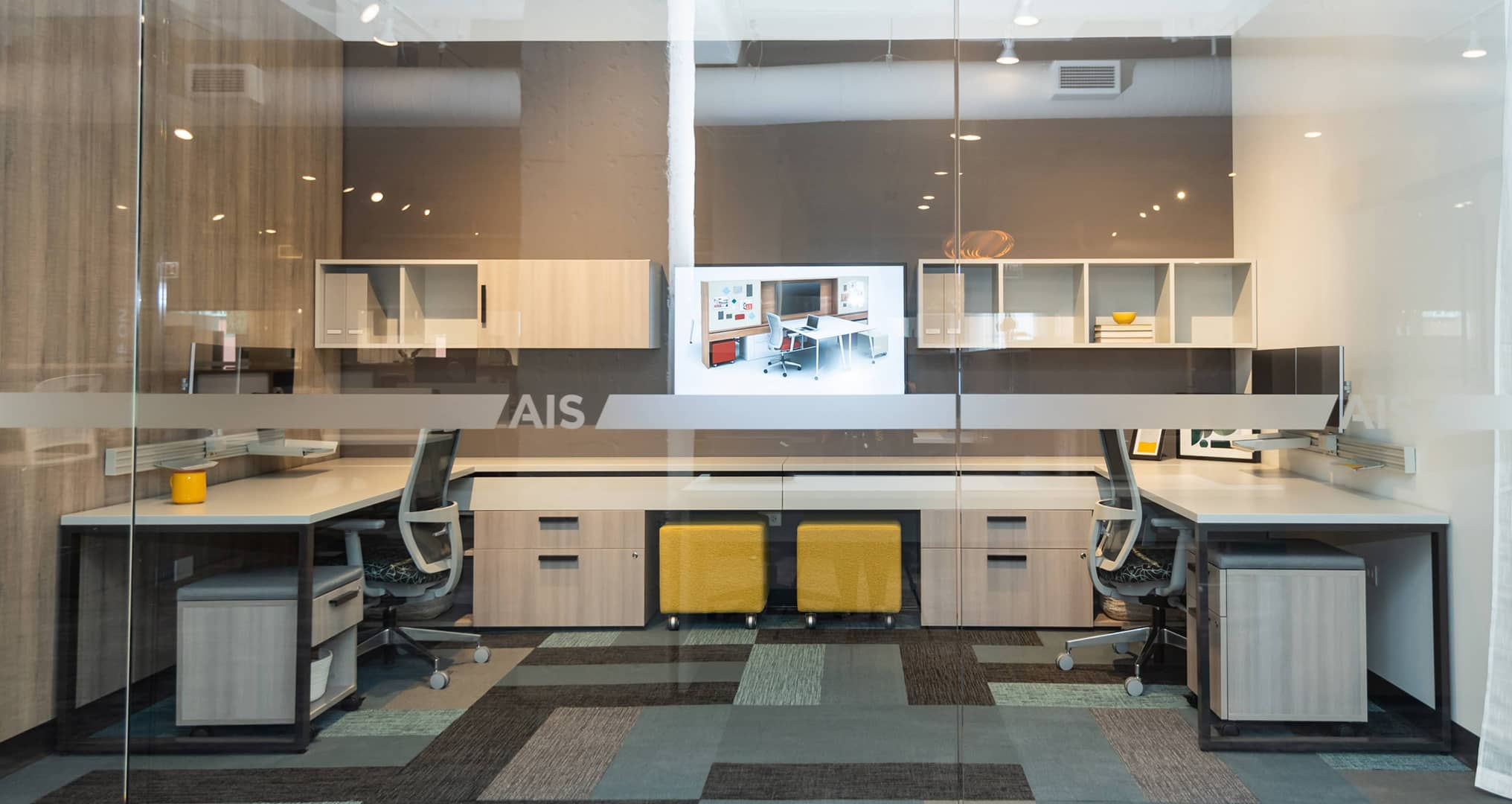 Office cubicles with yellow accents and two office spaces